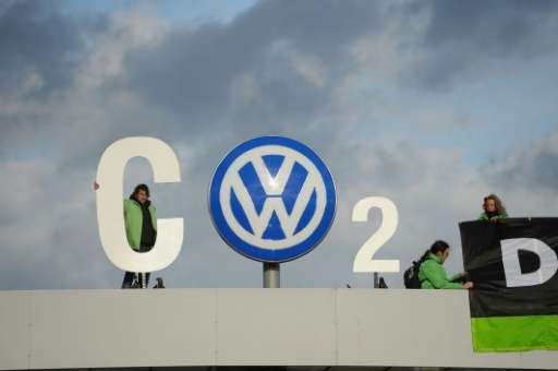 Greenpeace activists demonstrate at the entrance to the Volkswagen plant in Wolfsburg, central Germany, on November 9, 2015