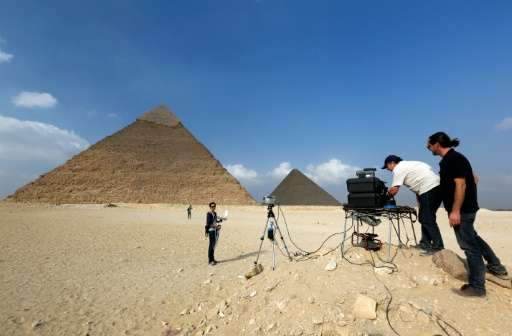"""A photo released by researchers on November 10, 2015 shows engineers from the """"ScanPyramids"""" project using infrared th"""