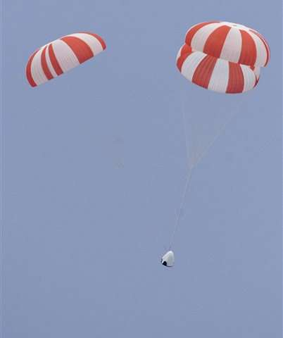 SpaceX capsule soars with dummy in first test of crew escape