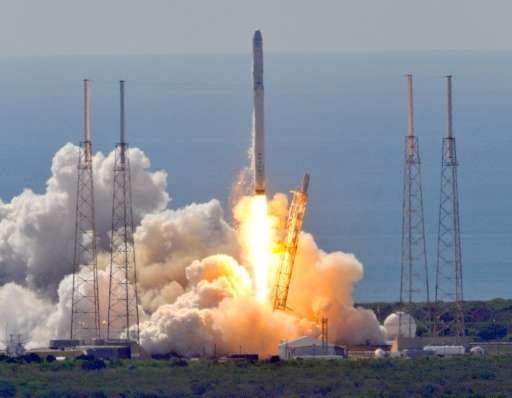 Space X's Falcon 9 rocket lifts off from space launch complex 40 at Cape Canaveral, Florida on June 28, 2015