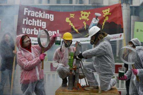 Environmentalists demonstrate in front of the Chancellery in Berlin on April 1, 2015