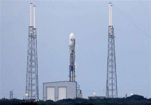 SpaceX tries again to launch observatory, nixes landing test