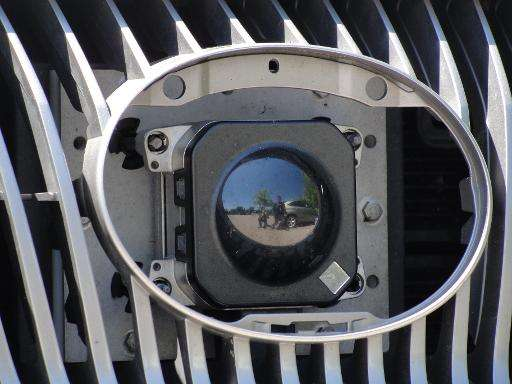 A camera peers out from the front grill of Google's self-driving car in Mountain View, California, on May 13, 2014