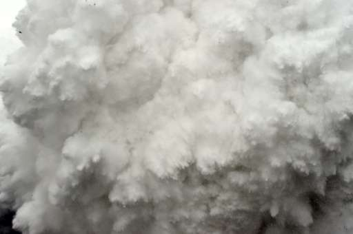 A cloud of snow and debris is captured April 25, 2015, just before it flattened part of Everest Base Camp in the Himalayas, wher