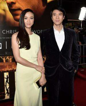 """Actors Tang Wei (L) and Wang Leehom at the premiere of """"Blackhat"""" at the Chinese Theatre on January 8, 2015"""