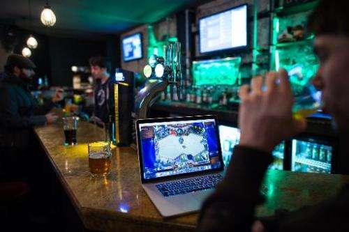 "A gamer drinks a beer at ""e-sport"" bar Meltdown, the only one of its kind in Britain, in north London on February 14,"