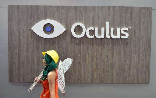 A girl in a costume walks by the Oculus booth at the Game Developers Conference in San Francisco, California on March 4, 2015
