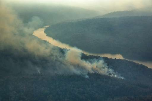"A Greenpeace photo taken October 24, 2015 shows forest fires in the Arariboia indigenous lands in Brazil—""one of the bigges"