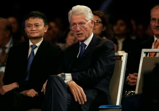 Alibaba Group chairman Jack Ma (L), pictured with former US President Bill Clinton on September 29, 2015, is among backers of th