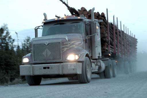 A logging truck carries wood from the boreal forest to a sawmill near the Broadback River in northern Quebec
