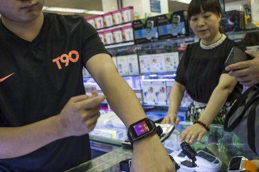 A man shows off a Chinese-made copy of the Apple Watch in Huaqiangbei Commercial Street in the southern Chinese city of Shenzhen