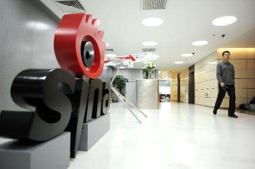 A man walks past the entrance to the offices of Sina Weibo, widely known as China's version of Twitter, in Beijing