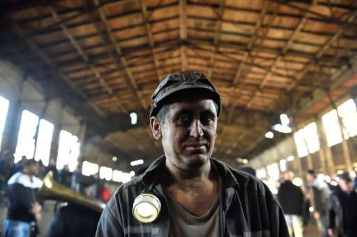 A miner is seen at the end of his last shift at the coal mine in the Romanian city of Petrila, on October 30, 2015