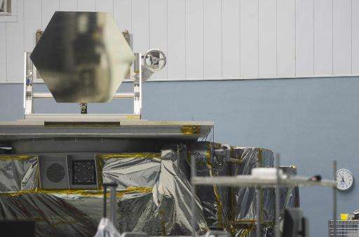 A mirror, similar to the one that will be installed on the James Webb Space Telescope, is displayed in a clean room at the NASA