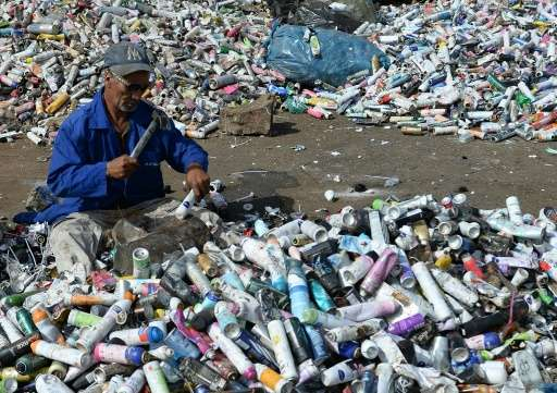 A Moroccan labourer recycles waste at the Attawafoq cooperative at Oum Azza industrial landfill in Ain Aouda