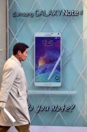 An advert for Samsung Galaxy Note 4 is seen outside a shop in Seoul, on January 8, 2015