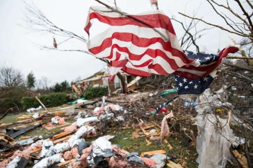 An American flag placed by first responders is seen December 27, 2015 in the aftermath of an unseasonable tornado in Rowlett, Te