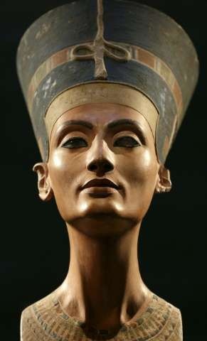 "A Nefertiti bust is pictured during the exhibition ""In The Light Of Amarna"" to mark the 100 years of the Nefertiti bus"