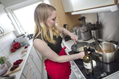 Anne Sofie Udklit Soerensen prepares a meal in her private kitchen in order to sell it on the DinnerSurfer website, one of a var