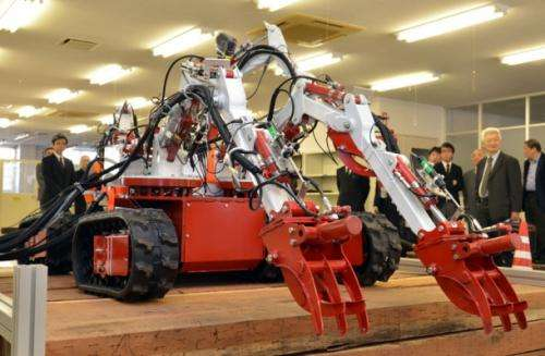 An 'octopus' robot with eight limbs developed to clear rubble in Fukushima, Japan
