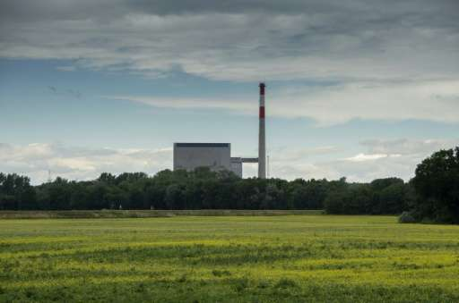 A nuclear power plant was built in Zwentendorf, Austria, but was never used and sits in a sea of green fields and wild flowers b