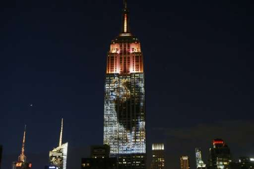 A photo of Cecil the Zimbabwean lion, who was killed by an American dentist causing international outrage, is projected on the E
