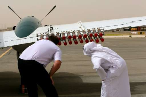 A pilot and a UAE official from the national center for meteorology and seismology check salt flares at al-Ain airport that are