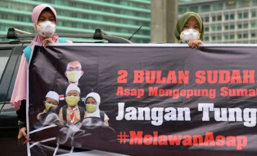 A rally in Jakarta on October 7, 2015 calls on the government to act to combat the haze caused by recent forest fires in Indones