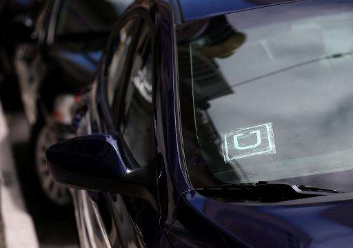 A sticker with the Uber logo is displayed in the window of a car on June 12, 2014 in San Francisco, California