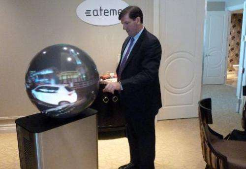 Ateme general manager Mike Antonovich demonstrates the LiveSphere 360-degree television system on January 9, 2015 in Las Vegas,