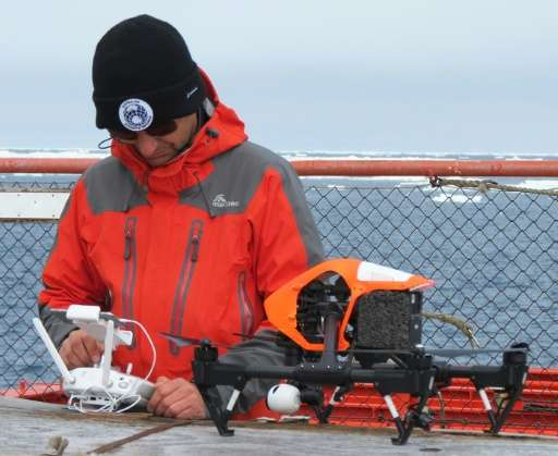 Australian UAV director James Rennie, seen with a quadcopter drone on the deck of the Australian Antarctic Division ice-breaker,