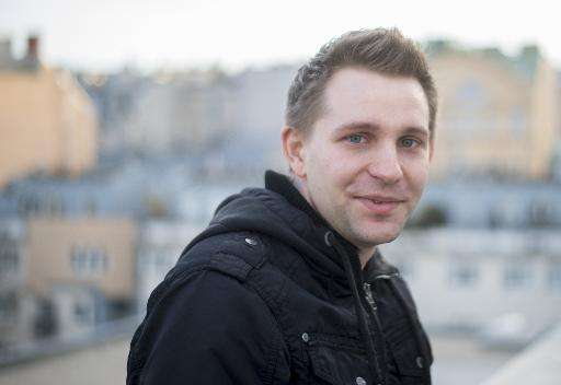 Austrian activist Max Schrems poses for a photographer in Vienna, Austria on April 7, 2015