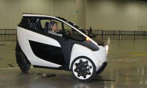 A visitor negotiates a course in a 3-wheel Toyota i-ROAD urban mobility prototype being demonstrated at the TED Conference in Va