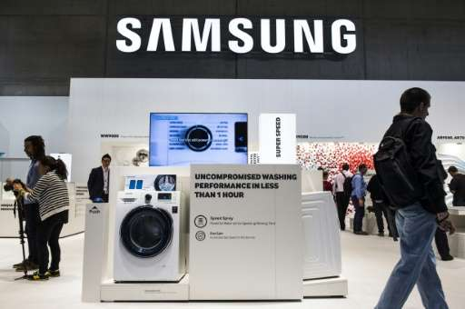 A washing machine is featured in the Samsung booth at the IFA electronics trade fair in Berlin on September 3, 2015