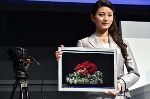"A woman displays Panasonic's new large tablet ""Toughpad 4K"" in Tokyo on June 23, 2015"