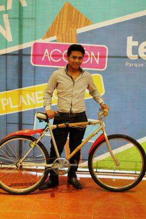 Bamboo bike recharges mobile devices and external batteries by peddling