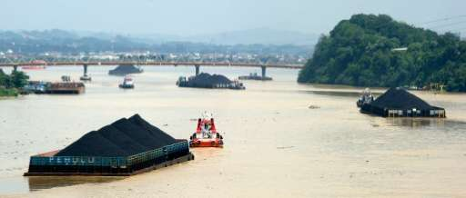 Barges carrying masses of coal float down the in Samarinda in Indonesia, one of the world's biggest exporters of coal
