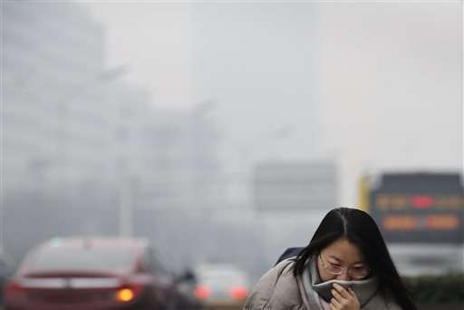 Beijing schools close as city issues 1st smog red alert