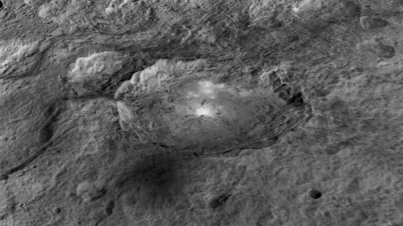 Bright spots and a pyramid-shaped mountain on Ceres