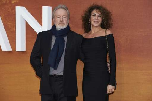 British filmmaker Ridley Scott (L) and his partner Costa Rican actress Giannina Facio pose for photographers as they arrive for
