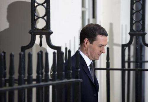 British Finance Minister George Osborne leaves 11 Downing Street in London, on March 18, 2015, as he prepares to unveiling the a