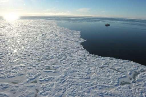 Canadian Coast Guard Ship (CCGS) Amundsen, a research icebreaker, navigates near an ice floe along Devon Island in the Canadian