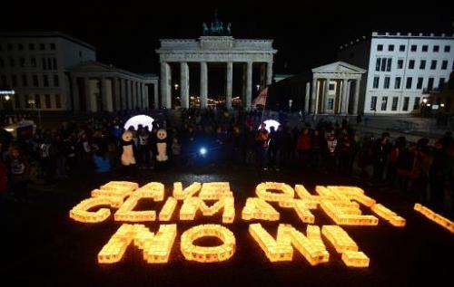 "Candles in paper bags are placed to form the lettering ""Save our climate, Now"" in Berlin during the global climate cha"