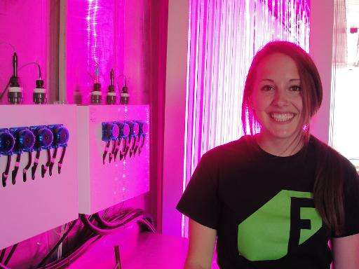 Caroline Katsiroubas of Freight Farms poses inside a shipping container outfitted to serve as a hydroponic garden where crops ca