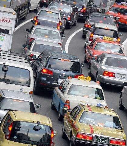 Cars jam a street in Tokyo
