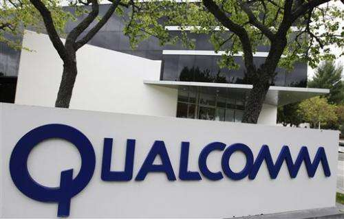 China fines Qualcomm record $975M in anti-monopoly case (Update)