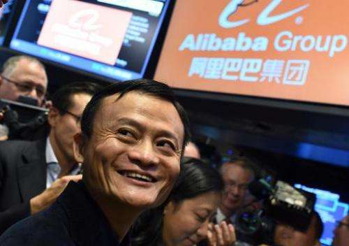 Chinese online retail giant Alibaba founder Jack Ma smiles while waiting for the trading to open at the New York Stock Exchange,