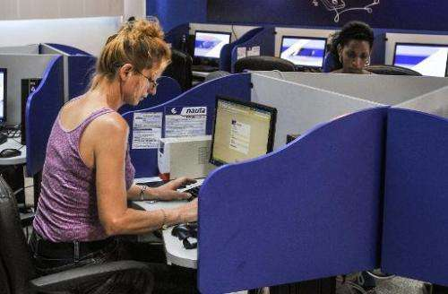 Cubans visit a cybercafe in Havana on June 21, 2013
