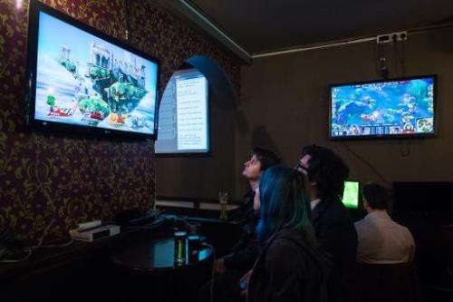 Customers come to the north London pub, pictured on February 14, 2015, to have a drink and watch a video game contest as others