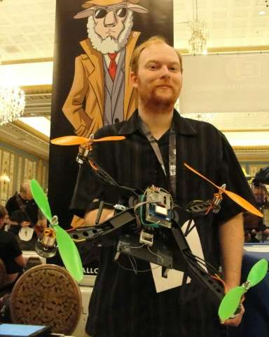 David Jordan displays an Aerial Assault drone during a Def Con hacker gathering in Las Vegas, Nevada, on August 9, 2015